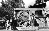 Andrew Terwilliger, Eugene Terwilliger and another next to the water wheel on the Terwilliger Ranch